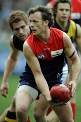 Melbourne's James McDonald gets ready to handball in the round 18 game against Richmond in 2009. The Demons lost by four points.