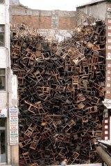 Turkey: <em>1,500 Chairs Stacked Between Two City Buildings</em> by Doris Salcedo, 2003.