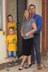 Alarmed ... police officer Tony Wood and his family, whose Nyngan home was contaminated.
