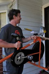 Ben Swaik from Sidekicker delivers a smoothie making bike to Leena Van Raay's door.