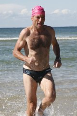 Blue ties and budgie smugglers: Tony Abbott competes in a tram triathlon in 2008.