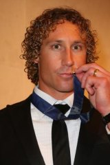 A kiss for Charlie: Matt Priddis lifts his Brownlow Medal to his lips after the presentation ceremony on Monday night.