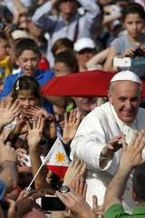 Pope Francis waves as he arrives to lead a Pentecost vigil mass in Saint Peter's Square at the Vatican.