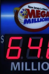 A storefront sign displays the jackpot total of the Mega Millions lottery in Hoboken, New Jersey.