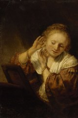 Rembrandt's Young woman trying on earrings, 1657, is among items from Russia's Hermitage to go on show in Melbourne.