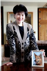 Four-Legs good … Ying Ying with a picture of her beloved dog, Max.