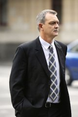 Former Victoria Police media director Stephen Linnell leaves court yesterday.