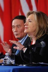 US Secretary of State Hillary Clinton as China's Vice Premier Wang Qishan looks on during closing remarks during the 2011 US-China Strategic Economic Dialogue.