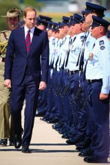 Prince William inspects an honour guard at RAAF Base Amberley.