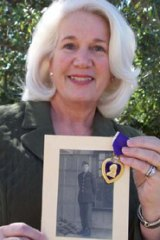 Suzanne Mitchell, a great-niece of Sergeant Richard Owen's widow, Ruth - with the lost picture of the paratrooper and his Purple Heart.