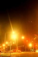 Glare from urban street lights plays havoc with wet roads.