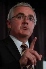 Independent MP Andrew Wilkie says Eddie McGuire is using 'inflammatory terms' by labelling pokie reforms a 'footy tax'.