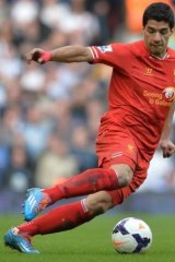 Happy feet: Liverpool's Luis Suarez has been devastating for the Liverpool season.