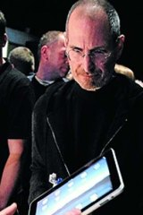Apple's Steve Jobs with the original iPad.
