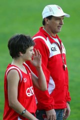 Paul Roos and his son. Roos faces an AFL code-of-conduct hearing tomorrow night.
