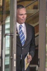 Craig Thomson leaving the Melbourne Magistrates court.