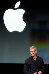 Apple CEO Tim Cook speaks at the event.