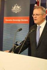 Immigration minister Scott Morrison addresses journalists.