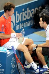 Worse for wear ... Andy Murray receives treatment during his first-round win over Kazakh Mikhail Kukushkin.