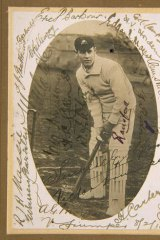 A souvenir photograph of cricketer Victor Trumper autographed by players at his 1913 testimonial match.