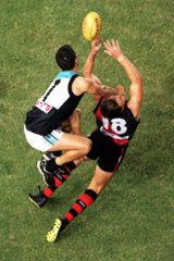 Matthew Lloyd flies for a mark during the first AFL match at Docklands.