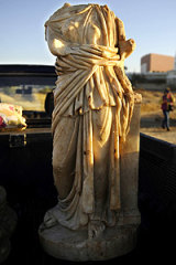 The storm uncovered this statue in Ashkelon and smashed retaining walls protecting the port of Caesarea.
