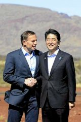 Australia's Prime Minister Tony Abbott and his Japanese counterpart Shinzo Abe arrive to tour the Rio Tinto West Angelas iron ore mine.