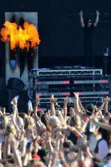 Throw your hands in the air... Skrillex works the crowd at the Future Music Festival.