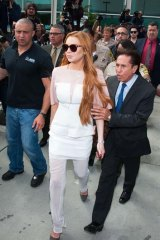 Sentenced: Lindsay Lohan (left) leaving with her lawyer.