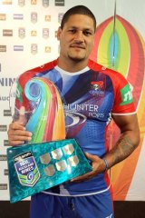 Willie Mason poses with the Nines trophy.