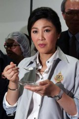 Yingluck Shinawatra ...  Her government is seeking to offload record stockpiles of rice built up through a state-buying program.