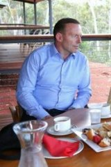 Abbott has a cup of tea with Galarrwuy Yunupungu, leader of the Gumatj clan.