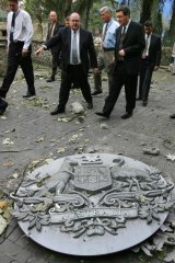 Australia's then Foreign Minister Alexander Downer inspects the damage with Ambassador David Ritchie.