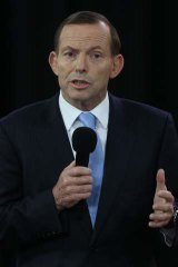 Unwavering: Tony Abbott defends his budget management plans at Rooty Hill RSL despite relentless queries from Kevin Rudd.