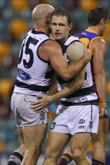 Geelong's Joel Selwood (right) and Paul Chapman celebrate a goal against the Brisbane Lions. But Selwood has a nervous wait ahead of the match review panel's scrutiny of the game.