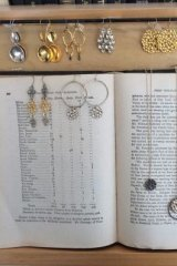 New uses: Jewellery displayed in a shop using an old book.