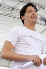 Stand ... GetUp! national director Simon Sheikh addresses the rally.