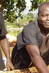 A worker with Ghana's Kuapa Kokoo farmers' co-operative with Fairtrade-certified beans.