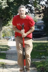 Ashrita Furman chops 40 potatoes in a minute with the blade of his shovel, hopping from one to the next.