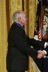 John Howard (L) shakes hands with  George W. Bush after Bush presented him with the Presidential Medal of Freedom.