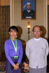 Moving forward ... Myanmar's democracy icon Aung San Suu Kyi, left, and President Thein Sein.