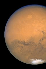 Mars with its trademark red hue.