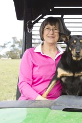 Country life: Williams with his wife, Nancy Capel, and Emmie the kelpie on their farm in Rob Roy, near Inverell in NSW.