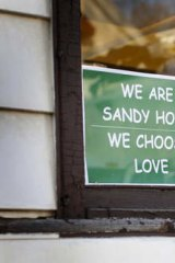 Message of support: The sign designed by Tim Stan has been popping up all over Sandy Hook.