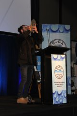 "Icon Water employee Sam Bracken does a ""shoey'' to celebrate the ACT having better-tasting water than NSW."
