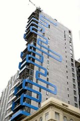 A blue ribbon of steel wraps its way around the 6.7-metre wide tower.