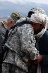 American Brigadier-General Michael Ryan consoles an Afghan man after the US Army killed 13 civilians in Herat province while targeting Taliban insurgents.