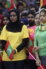 Government supporters rally against religious extremism in Male, Maldives.