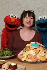 Elmo and Cookie Monster with Kylie Northover.