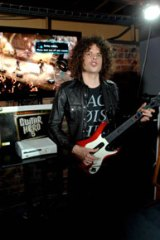 Coming to a living room near you...Woolfmother's Andrew Stockdale plays guitar Hero 5 at Enmore Hotel last month.